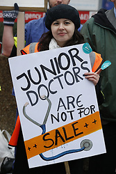 © Licensed to London News Pictures. 10/02/2016. London, UK. Junior doctors stand on a picket line outside St Thomas' Hospital. Doctors are holding a one day strike over proposed new working hours - only the second strike in 40 years. Photo credit: Peter Macdiarmid/LNP