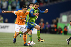 November 30, 2017 - Seattle, Washington, U.S - Soccer 2017: Sounder CRISTIAN ROLDAN (7) works against Dynamo midfielder TOMAS MARTINEZ (25) as the Houston Dynamo play the Seattle Sounders in the 2nd leg of the MLS Western Conference Finals match at Century Link Field in Seattle, WA. (Credit Image: © Jeff Halstead via ZUMA Wire)