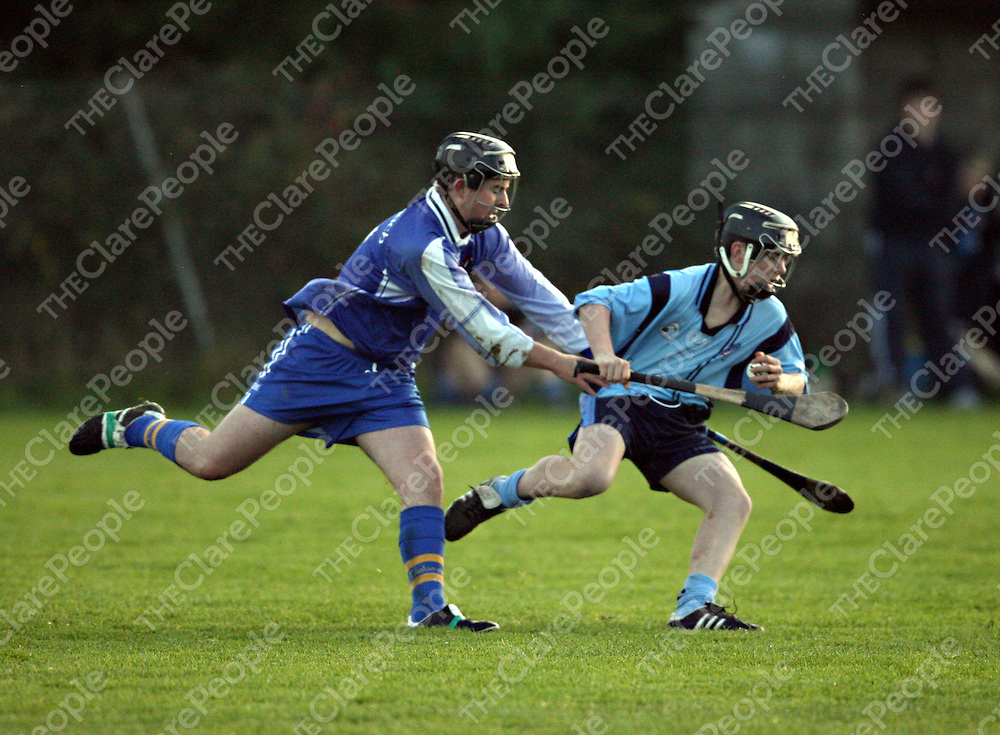 St. Caimins Pa Sheehan holds off Nenagh's Niall Madden during their Harty Cup clash in Scariff on Wednesday.<br />