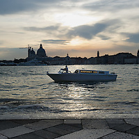 "VENICE, ITALY - MAY 31:A water taxi waits for VIP guests outside the Basilica of San Giorgio Maggiore after the press preview of Anish Kapoor installation ""Ascension"" at Basilica di San Giorgio on May 31, 2011 in Venice, Italy. ""Ascension"" is an installation that consist of a column of white smoke rising from a circular base placed at the intersection between the transet and the nave of Basilica of San Giorgio Maggiore"