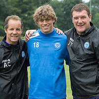 Despite the rain a clearly delighted Tommy Wright and coach Alec Cleland pictured with Murray Davidson this morning after he signed a new contract with St Johnstone....26.07.13<br /> Picture by Graeme Hart.<br /> Copyright Perthshire Picture Agency<br /> Tel: 01738 623350  Mobile: 07990 594431