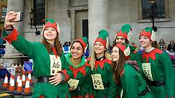 © Licensed to London News Pictures. 07/12/2019. LONDON, UK.  7 December 2019. Participants dressed as elves take a selfie ahead of The 39th Great Christmas Pudding Race in Covent Garden, raising funds for Cancer Research as well as having lots of festive fun.  Photo credit: Stephen Chung/LNP