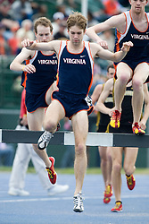 Chris Clark of Virginia clears the water hazard in the men's 3000m steeplechase.  The Virginia Cavaliers men's and women's track and field teams hosted the Missouri Tigers.  The Virginia women defeated Missouri while the Mizzou men defeated UVA on April 5, 2008 at The University of Virginia's Lannigan Field in Charlottesville, VA.
