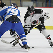 Nikolay Perunov #2 of the MIT Engineers faces off with Avishai Geller #19 of the Israel National Team during the game at Johnson Ice Rink on March 1, 2014 in Cambridge, Massachusetts . (Photo by Elan Kawesch/CJP)