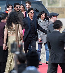 © Licensed to London News Pictures. 27/03/2015. Shah Rukh Khan (pictured centre in black suit) filming for his new Bollywood production 'FAN' at Blenheim Palace in Woodstock, Oxfordshire, UK on March 27, 2015. Shah Rukh Khan (Also known as SRK) has appeared in more than 80 Bollywood films and is considered to be one of the worlds biggest film and television stars. Photo credit: Mark Hemsworth/LNP