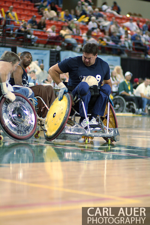 July 7th, 2006: Anchorage, AK - Scot Severn (9) maneuvers around trying to score as White defeated Blue in the gold medal game of Quad Rugby at the 26th National Veterans Wheelchair Games.