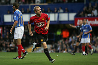 Photo: Lee Earle.<br /> Portsmouth v Manchester United. The FA Barclays Premiership. 15/08/2007.United's Paul Scholes turns away to celebrate after scoring their opening goal.