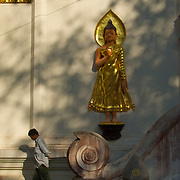 Man and Buddha, Wat Chom Choeng Temple in Chiang Saen, Chiang Rai Northern Thailand South East Asia.