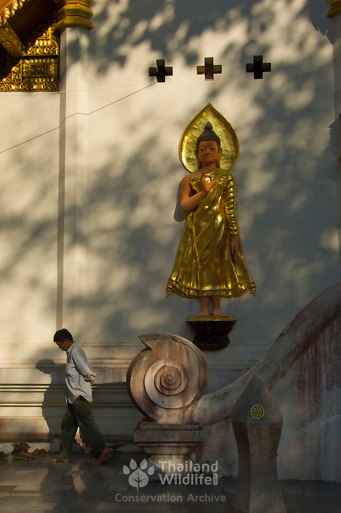 Man and Buddha, Wat Chom Choeng Temple in Chiang Saen, Chiang Rai Northern Thailand South East Asia.