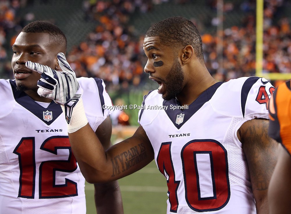 Houston Texans wide receiver Keith Mumphery (12) looks on as Houston Texans wide receiver DeAndre Hopkins (10) points and calls out after the 2015 week 10 regular season NFL football game against the Cincinnati Bengals on Monday, Nov. 16, 2015 in Cincinnati. The Texans won the game 10-6. (©Paul Anthony Spinelli)