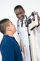 Doctor examining pre-teen (10-12) boy