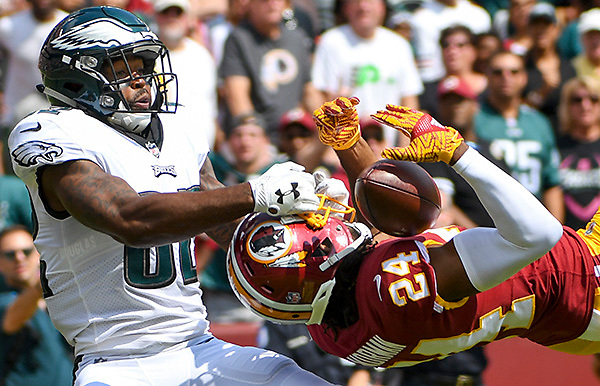 LANDOVER, MD - SEPTEMBER 10: Washington Redskins cornerback Josh Norman (24) nearly intercepts a first quarter pass intended for Philadelphia Eagles wide receiver Torrey Smith (82) on September 10, 2017, at FedExField in Landover, MD.(Photo by Mark Goldman/Icon Sportswire)