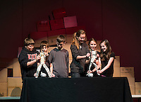 """6th grade students Isaac Wallace, Colby Oickle, Garrett Peaslee, Alexis Boisvert, Sara Jansury and Hannah Waite work their puppets during the presentation """"Scenes from Ancient Pompeii"""" with Artists in Residence Andrew and Bonnie Periale at Gilmanton Elementary School on Wednesday afternoon.  (Karen Bobotas/for the Laconia Daily Sun)"""