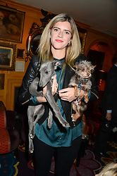 ANNABEL SIMPSON and dogs Rita & Coco at Tatler Magazine's Little Black Book Party held at Annabel's, Berkeley Square, London on 5th November 2013.
