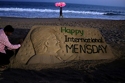 November 18, 2018 - Bhubaneswar, India - A sand sculpture is seen at the Bay of Bengal Sea's eastern coast beach at Puri, as it is creating by International sand artist Sudarshan Pattnaik on the eve of World Man's Day, 65 km away from the eastern Indian state Odisha's capital city Bhubaneswar, on 18 November 2018. (Credit Image: © Str/NurPhoto via ZUMA Press)