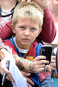 Young fan of FC Barcelona waits for players after press conference in The Polish Baltic Fr&eacute;d&eacute;ric Chopin Philharmonic in Gdansk, Poland.<br /> A few hours before friendly match between Lechia Gdansk and FC Barcelona.<br /> <br /> Poland, Gdansk, July 30, 2013<br /> <br /> Picture also available in RAW (NEF) or TIFF format on special request.<br /> <br /> For editorial use only. Any commercial or promotional use requires permission.<br /> <br /> Photo by &copy; Adam Nurkiewicz / Mediasport