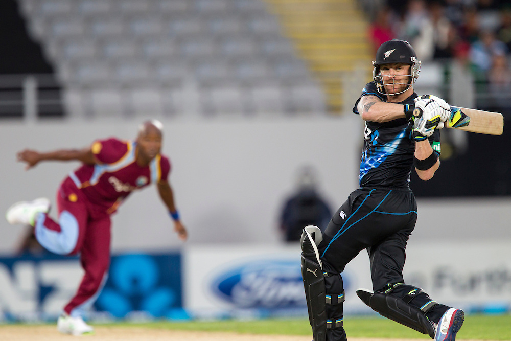 New Zealand's captain Brendon McCullum strikes a six from bowler West Indies' Tino Best  in the Twenty-20 International Cricket Match, Eden Park, Auckland, New Zealand, Saturday, January 11, 2014. Credit: SNPA/David Rowland
