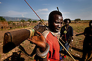 Jie warriors in their village in Jonglei state, Southern Sudan. The warrior generation defends their village against attacks and makes raids against other tribes to find the cattle neccessary to marry.