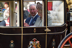 London, October 20th 2015. Following a Ceremonial welcoming to the UK by the Queen and The Duke of Edinburgh at Horse Guards Parade, a procession of carriages travels down the Mall past thousands of Chinese expatriates and Tibetan protesters. PICTURED: Prince Charles and the Duchess of Cornwall travel down the Mall in their carriage.