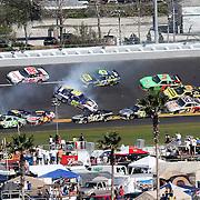 NASCAR Sprint Cup Series drivers Michael Waltrip (15), Andy Lally (71), Joe Nemechek (87) Greg Biffle (16) and David Reutimann (00) are involved in a multi car crash during the Daytona 500 at Daytona International Speedway on February 20, 2011 in Daytona Beach, Florida. (AP Photo/Alex Menendez)