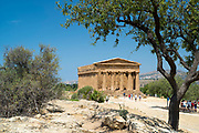 Tourists sightseeing at Temple of Concord ( Concordia) in the Valley of the Temples, Agrigento, Sicily, Italy