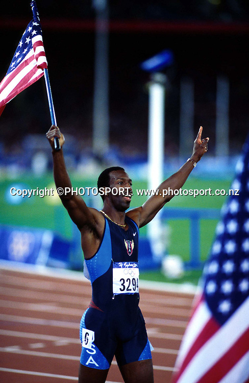 Michael Johnson (USA) celebrates after winning the Mens 400m Final at the Sydney Olympic Games, on September 25 2000. Photo: Andrew Cornaga/PHOTOSPORT<br />