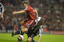 LIVERPOOL, ENGLAND - WEDNESDAY, SEPTEMBER 20th, 2006: Liverpool's Craig Bellamy tackled by Newcastle United's Scott Parker during the Premiership match at Anfield. (Pic by David Rawcliffe/Propaganda)