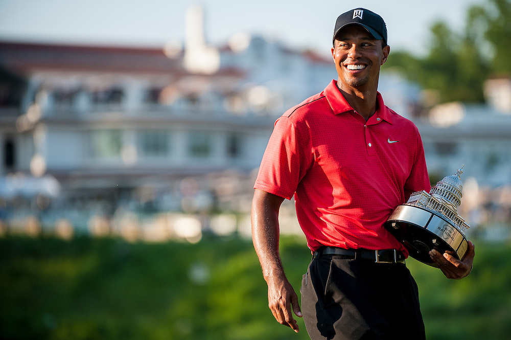 Tiger Woods with the trophy on the eighteenth hole at Congressional CC during the final round of the AT&T National in Bethesda, MD on Sunday. Woods shot a 2-under par 69 to finish 8 under and win the tournament.