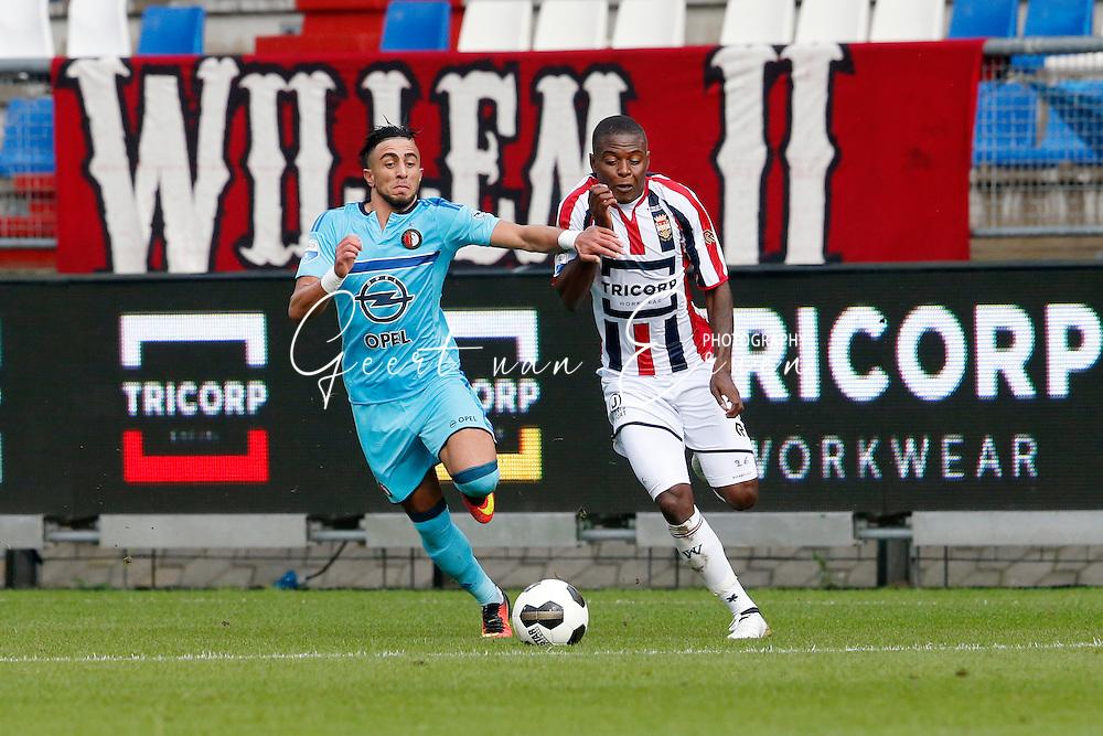 02-10-2016 VOETBAL:WILLEM II - FEYENOORD:TILBURG<br /> Bilal Basacikoglu van Feyenoord in duel met Derrick Tshimanga van Willem II <br /> <br /> <br /> Foto: Geert van Erven
