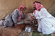 Al Amrah elders in the eastern province of Saudi Arabia. Conversation among the bedu is an art form. Dahna Sands, Saudi Arabia