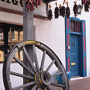 Antiquewagon wheel and traditional ristras in Old Town Albuquerque