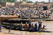 By 11:00 a.m. on Saturday, Kouakourou's weekly market has transformed the usually quiet shoreline of this Niger River backwater into a throng of bustling, thatch-shaded stalls and sharp-prowed traders' boats from up the river and down. Soumana goes to the market every week to buy and sell grain with his two wives, Pama and Fatoumata. Hungry Planet: What the World Eats (p. 209). The Natomo family of Kouakourou, Mali, is one of the thirty families featured, with a weeks' worth of food, in the book Hungry Planet: What the World Eats.