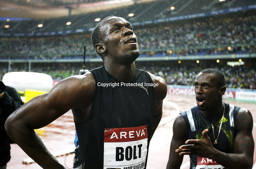 Usain Bolt and Daniel Bailey after the 100 metre event, at the IAAF Golden League Track and Field meeting on 17 July 2009 in Paris, France. Photo: Panoramic/PHOTOSPORT *** Local Caption ***