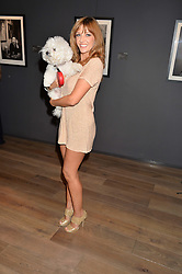 RACHEL GARLEY and her dog at a private view of photographs in aid of the Sir Hubert von Herkomer Arts Foundation held at Alon Fine Art, 5-7 Dover Street, London on 8th September 2015.