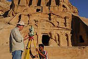 To gather data for his geo-archaeological system (GIS), a assistant of prodfessor Talal Akasheh use a teodolite in front of the Obelisk, one of the most important monuments of the Siq, the small canyon that gives access to Petra. With the next step of the project Akasheh, will complete a website for the Jordanian authorities, who can better manage the site, and academicians . He also intends to create a 3D documentation method as well as a non-destructive technique to study the salt content of the weathered monuments.