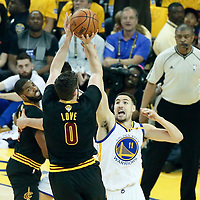 04 June 2017: Cleveland Cavaliers forward Kevin Love (0) takes a jump shot over Golden State Warriors guard Klay Thompson (11) during the Golden State Warriors 132-113 victory over the Cleveland Cavaliers, in game 2 of the 2017 NBA Finals, at the Oracle Arena, Oakland, California, USA.