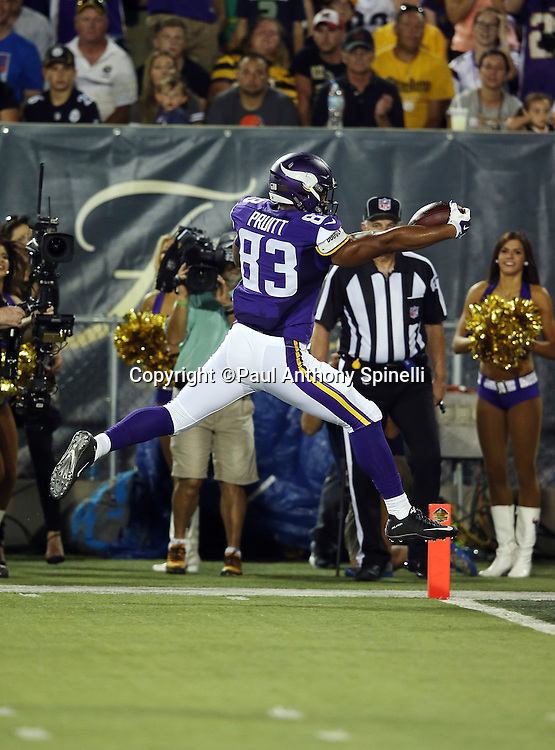 Minnesota Vikings rookie tight end MyCole Pruitt (83) leaps into the end zone as he scores a touchdown on a 34 pass and run play in the second quarter that gives the Vikings a 7-3 lead during the 2015 NFL Pro Football Hall of Fame preseason football game against the Pittsburgh Steelers on Sunday, Aug. 9, 2015 in Canton, Ohio. The Vikings won the game 14-3. (©Paul Anthony Spinelli)