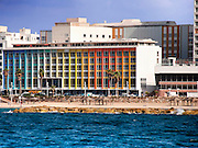 Israel, Tel Aviv coast line and cityscape dominated by the colourful facade of the Dan Hotel by Agam