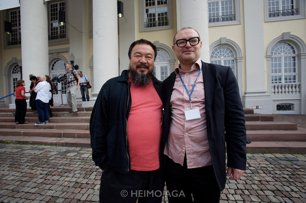 documenta12. Official photo op of documenta staff and artists at Fridericianum..Chinese artist Ai Weiwei (l.), Georg Schoellhammer.