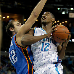 Oct 10, 2009; New Orleans, LA, USA; New Orleans Hornets center Hilton Armstrong (12) drives against Oklahoma City Thunder center Nenad Krstic (12) during the first quarter at the New Orleans Arena. Mandatory Credit: Derick E. Hingle-US PRESSWIRE
