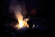 "An heroin user burns garbage to warm up after a night spent in the cold, somewhere on the ground. Rawalpindi, Pakistan, on thursday, November 27 2008.....""Pakistan is one of the countries hardest hits by the narcotics abuse into the world, during the last years it is facing a dramatic crisis as it regards the heroin consumption. The Unodc (United Nations Office on Drugs and Crime) has reported a conspicuous decline in heroin production in Southeast Asia, while damage to a big expansion in Southwest Asia. Pakistan falls under the Golden Crescent, which is one of the two major illicit opium producing centres in Asia, situated in the mountain area at the borderline between Iran, Afghanistan and Pakistan itself. .During the last 20 years drug trafficking is flourishing in the Country. It is the key transit point for Afghan drugs, including heroin, opium, morphine, and hashish, bound for Western countries, the Arab states of the Persian Gulf and Africa..Hashish and heroin seem to be the preferred drugs prevalence among males in the age bracket of 15-45 years, women comprise only 3%. More then 5% of whole country's population (constituted by around 170 milion individuals),  are regular heroin users, this abuse is conspicuous as more of an urban phenomenon. The substance is usually smoked or the smoke is inhaled, while small number of injection cases have begun to emerge in some few areas..Statistics say, drug addicts have six years of education. Heroin has been identified as the drug predominantly responsible for creating unrest in the society."""