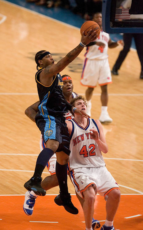 Carmelo Anthony of the Denver Nuggets goes to the hoop ahead of David Lee of the New York Knicks at Madison Square Garden, New York on Saturday  16 December 2006. (Andrew Gombert for The New York TImes)<br />