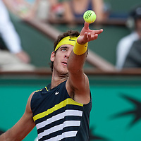 1 June 2009: Juan Martin Del Potro of Argentina eyes the ball as he serves during the Men's Single Fourth Round match on day nine of the French Open at Roland Garros in Paris, France.