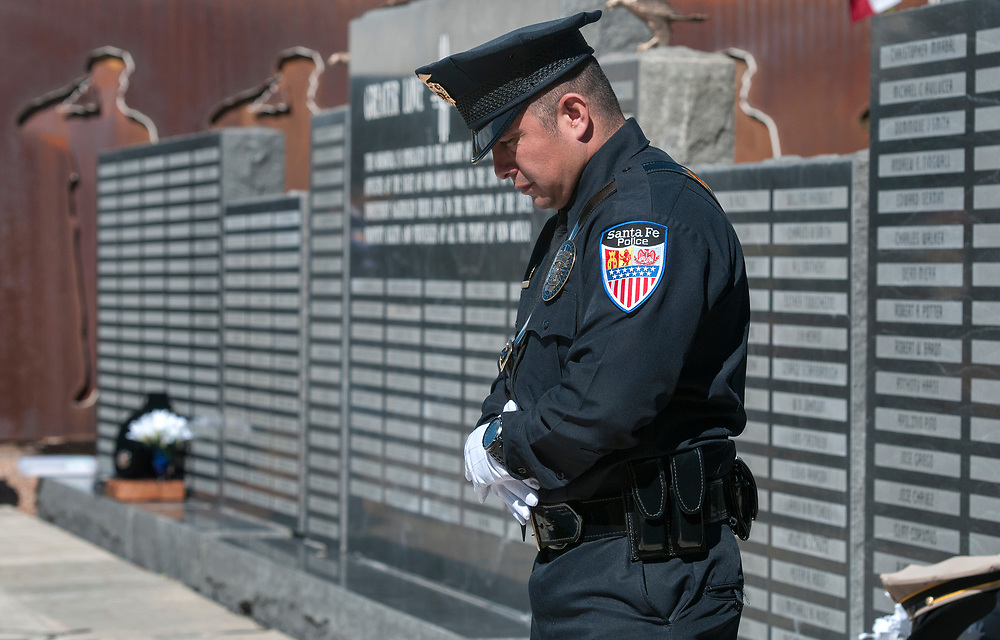 em052417m/a/Santa Fe Police Officer Daniel Escalon stands near the memorial wall during the annual New Mexico Law Enforcement Memorial Service at the Department of Public Safety Law Enforcement Academy in Santa Fe, Wednesday May 24, 2017. This year three names were added to the wall, Hatch Police Officer Jose Chavez, Alamogordo Police Officer Clint Corvinus and Valencia County Sheriff's Deputy Ryan Thomas. Gov. Susana Martinez spoke at the event.  (Eddie Moore/Albuquerque Journal