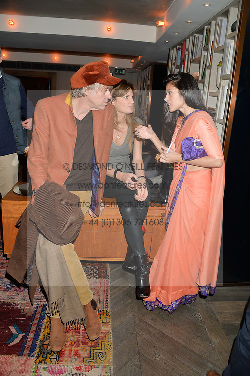 Left to right, SIR BOB GELDOF, JEMIMA KHAN and FATIMA BHUTTO at a reception to celebrate the publication of The Shadow of The Crescent Moon by Fatima Bhutto at the Belgraves Hotel, 20 Chesham Place, London, on 2nd December 2013.