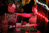 Emily and Luke cheering on the singers during karaoke night Saturday, Oct. 1, 2011 at the Westwood.