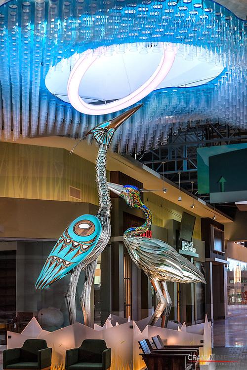 Metalwork native sculpture of herons in Tsawwassen Mills Mall