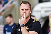 A thoughtful Newport County manager Mike Flynn during the EFL Sky Bet League 2 match between Northampton Town and Newport County at the PTS Academy Stadium, Northampton, England on 14 September 2019.