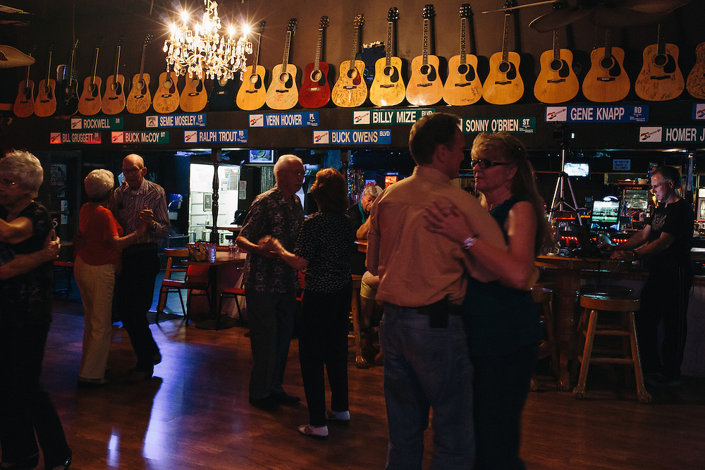 Patrons dance to the live music of Red Simpson, a founder of the Bakersfield Sound, on a Monday night at Trout's. Trout's is a honky tonk bar in Oildale, a community north of Bakersfield, California. The bar is known for performing acts like Bakersfield natives Merle Haggard and Buck Owens.