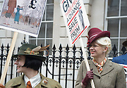 "Picture by Mark Larner. Picture shows chaps (and chapesses) gathered outside Abercrombie & Fitch's London store to protest against the proposed opening of an A&F store on Savile Row, the centuries old home of bespoke tailoring. 23/04/2012..Press release from The Chap Magazine:-.""On Monday, 23rd April 2012 (St Georges Day) several hundred immaculately dressed Chaps and Chapettes will gather outside number 3, Savile Row, to protest in the strongest possible terms against the opening of a childrens clothes shop there by Abercrombie & Fitch.The Chap feels that this city is already overwhelmed with American-style chain stores selling overpriced T-shirts and hooded sporting garments for those who rarely do any sport. Savile Row has been the home of gentlemens bespoke tailoring for over 200 years, and the opening of this store would signal the end of this one little street being allowed to devote itself to a single trade.""."